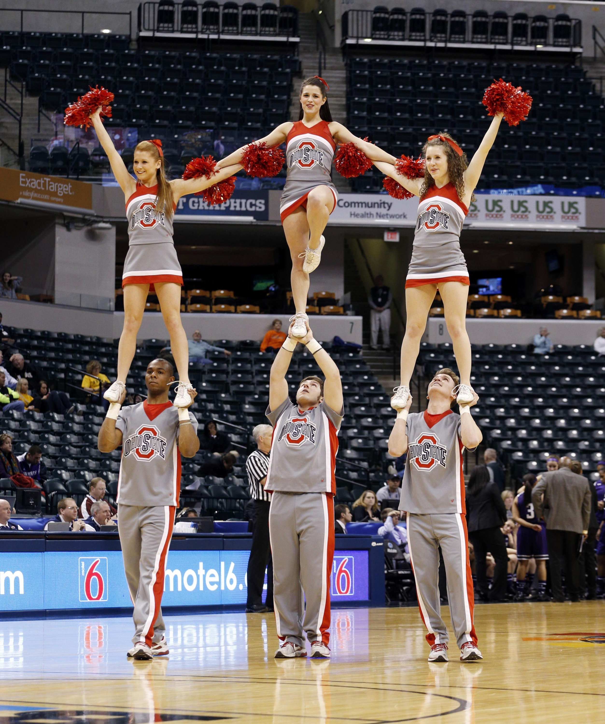 Mar 6, 2014; Indianapolis, IN, USA; Ohio State Buckeyes cheerleaders perform a cheer during a game against the Northwestern Wildcats at Bankers Life Fieldhouse. Ohio State defeats Northwestern 86-77.  Mandatory Credit: Brian Spurlock-USA TODAY Sports