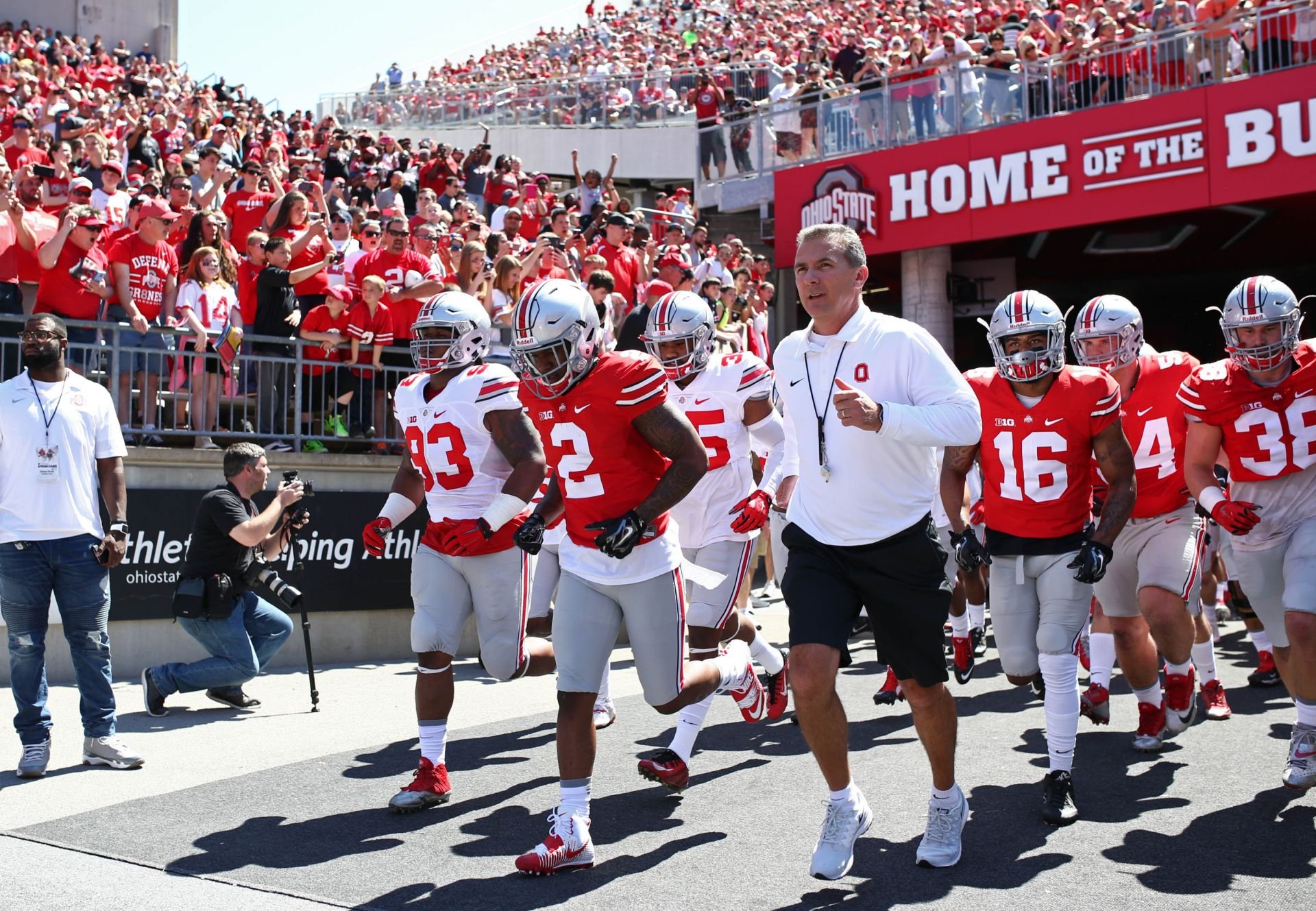 Ohio State head coach Urban Meyer leads the Scarlet and Gray teams onto the field prior to the spring game at Ohio Stadium. Aaron Doster-USA TODAY Sports
