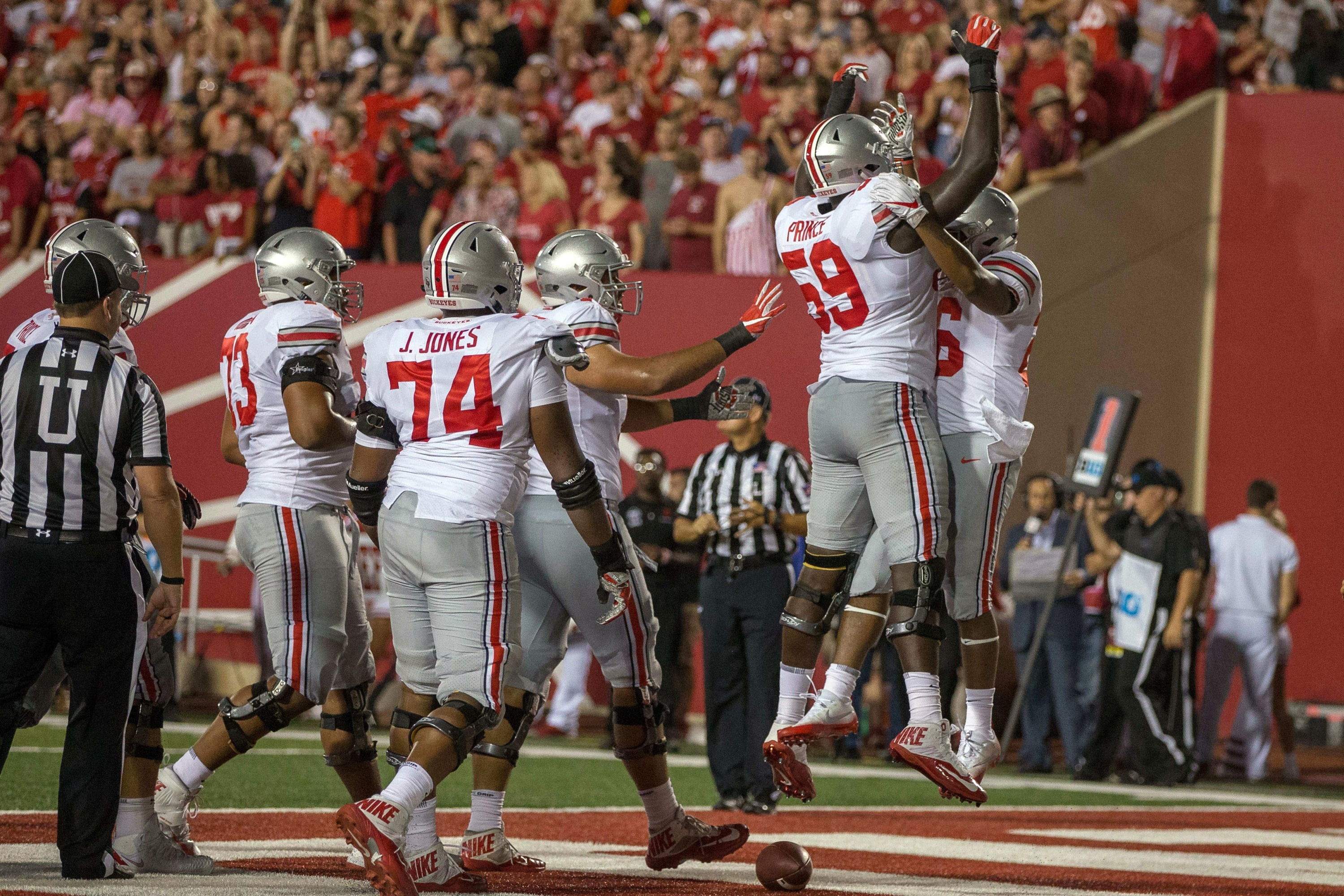 Aug 31, 2017; Bloomington, IN, USA; Ohio State Buckeyes running back Antonio Williams (26) celebrates his touchdown with offensive lineman Isaiah Prince (59) in the second quarter of the game Indiana Hoosiers at Memorial Stadium. Mandatory Credit: Trevor Ruszkowski-USA TODAY Sports