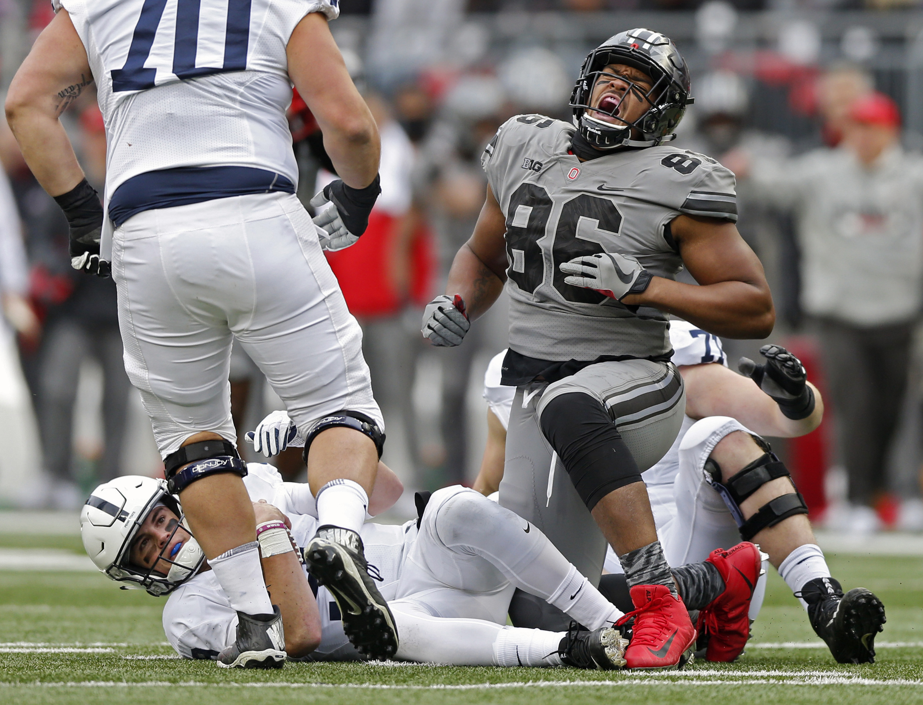 Ohio State Buckeyes defensive lineman Dre'Mont Jones (86) sacks Penn State Nittany Lions quarterback Trace McSorley (9) during the 1st half of their game in Ohio Stadium on October 28, 2017.  [Kyle Robertson/Dispatch]