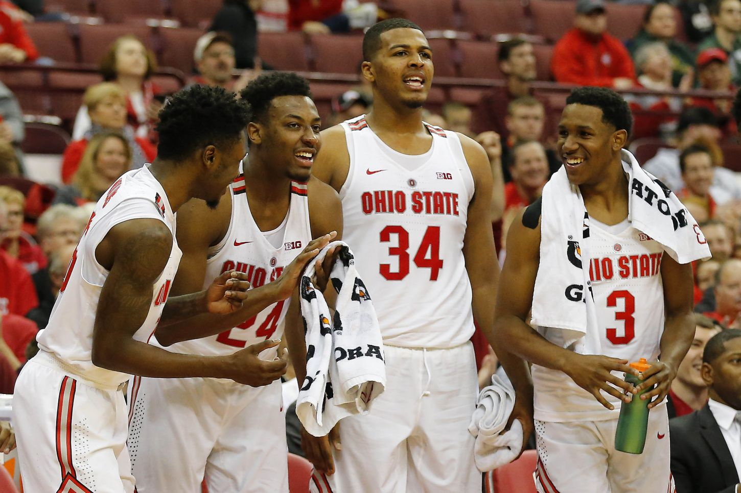 Dec 9, 2017; Columbus, OH, USA; Ohio State Buckeyes players (from left) Ohio State Buckeyes guard Kam Williams (15), Ohio State Buckeyes forward Andre Wesson (24), Ohio State Buckeyes forward Kaleb Wesson (34), and Ohio State Buckeyes guard C.J. Jackson (3) celebrate as the team wins comfortably over William & Mary Tribe during the second half at Value City Arena. Mandatory Credit: Joe Maiorana-USA TODAY Sports